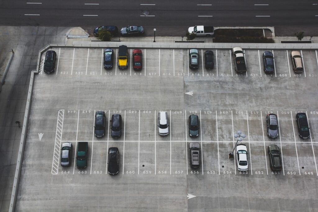 an aerial photograph of a parking lot